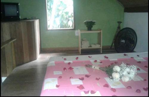 Cama ou camas em um quarto em Chale Das Flores
