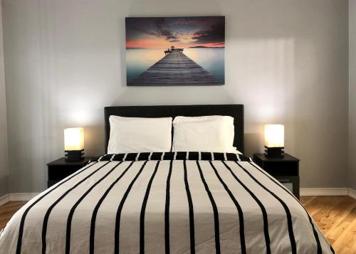A bed or beds in a room at Modern Home w/ Private Pool 10mi from Disney
