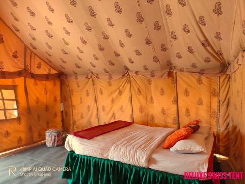A bed or beds in a room at Aster Desert Camp