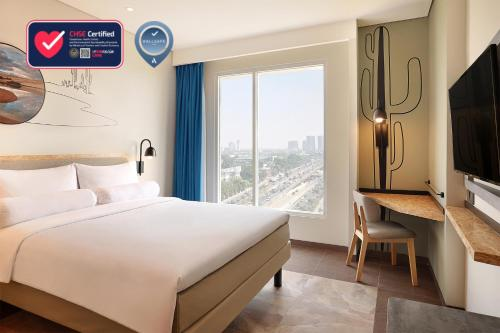 A bed or beds in a room at ibis Styles Jakarta Simatupang