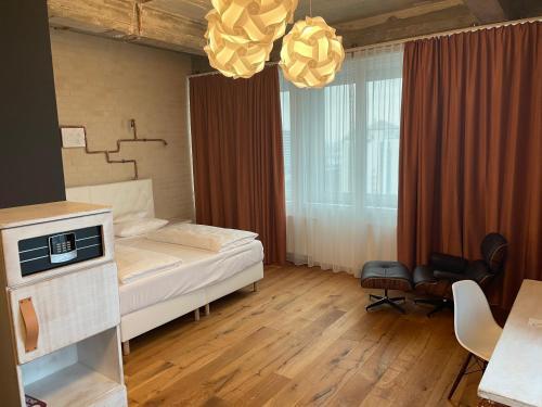 Ein Bett oder Betten in einem Zimmer der Unterkunft Loftstyle Hotel Hannover; Best Western Signature Collection