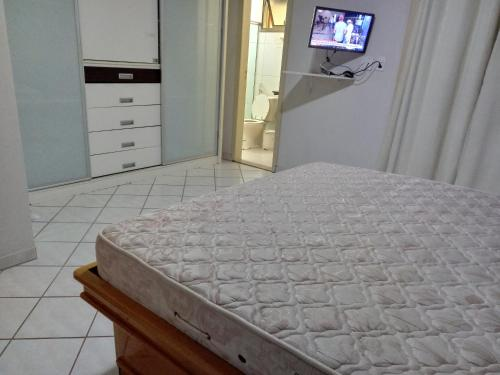 A bed or beds in a room at Casa de Temporada com Piscina