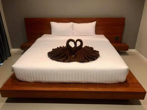 A bed or beds in a room at JANSAVANG BOUTIQUE HOTEL