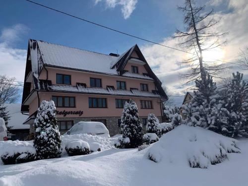 Pokoje Gościnne U Małgorzaty during the winter