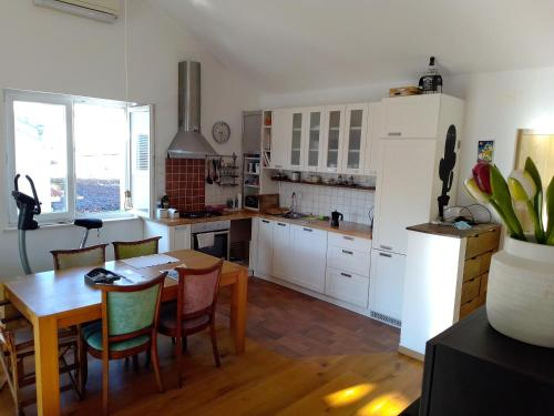 A kitchen or kitchenette at Loft Pianino Apartment with a Big Terrace