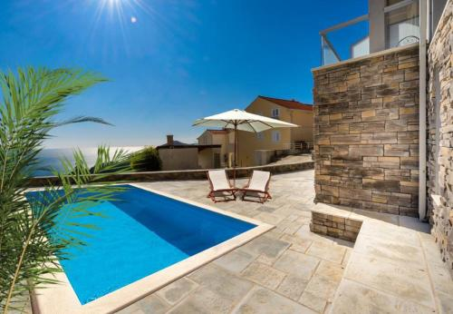 The swimming pool at or close to Apartments Villa Capitano