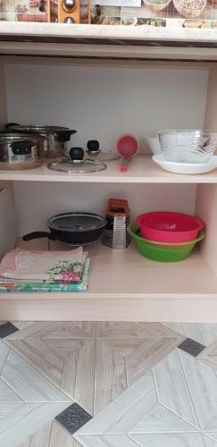 Кухня или мини-кухня в Апартаменты У Марии