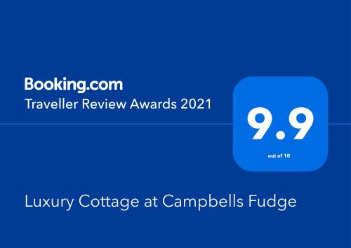 A certificate, award, sign, or other document on display at Luxury Cottage at Campbells Fudge