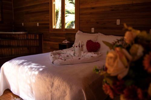 Cama ou camas em um quarto em Pousada Cascata Véu de Noiva