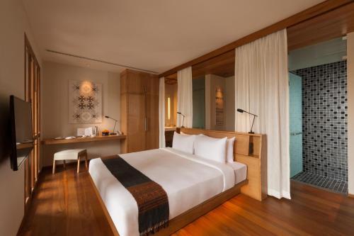 Avani+ Luang Prabang Hotelにあるベッド