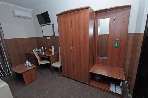 Телевизор и/или развлекательный центр в Отель Прага
