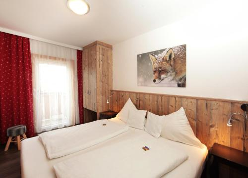 A bed or beds in a room at Apartmenthaus Gotthardt