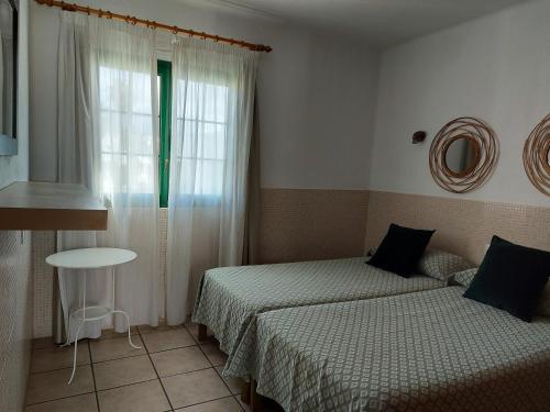 A bed or beds in a room at Apartamentos Acuario Sol