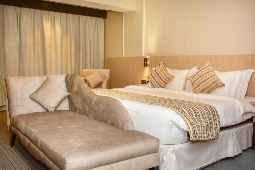 Cama ou camas em um quarto em هيفن بلازا
