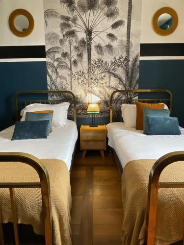 Ein Bett oder Betten in einem Zimmer der Unterkunft Le Boutik Hotel