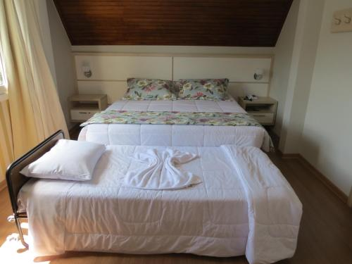 Cama ou camas em um quarto em Olidal Pousada da Serra