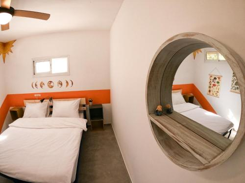 A bed or beds in a room at Golan Heights Hostel