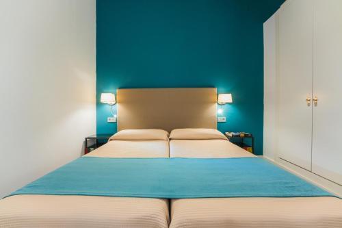 Säng eller sängar i ett rum på Debambu Larios