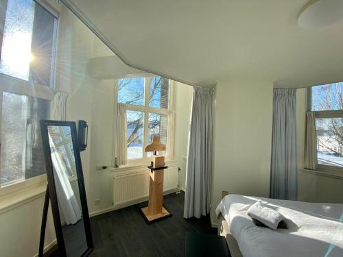 A bed or beds in a room at Watertoren Middelburg