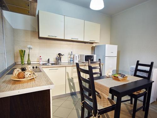 Кухня или мини-кухня в Zona Komforta