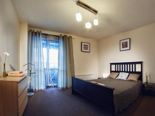 Кровать или кровати в номере Zona Komforta