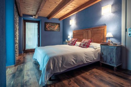A bed or beds in a room at Rifugio Lilla