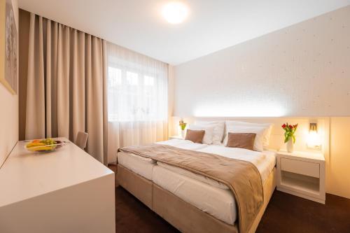 Postel nebo postele na pokoji v ubytování Hotel Vila Viola