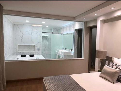Um banheiro em Hotel Guarany