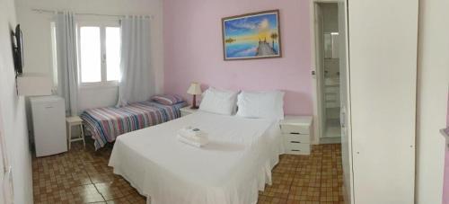 Cama ou camas em um quarto em Nascimento Suites