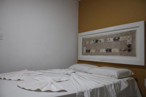 A bed or beds in a room at Pousada Kaluanã- Prospar Administradora