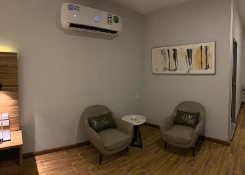 Uma área de estar em SAS RTL Hotel