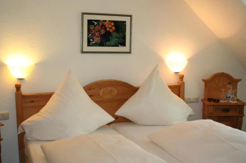Een bed of bedden in een kamer bij Hotel Hieronimi