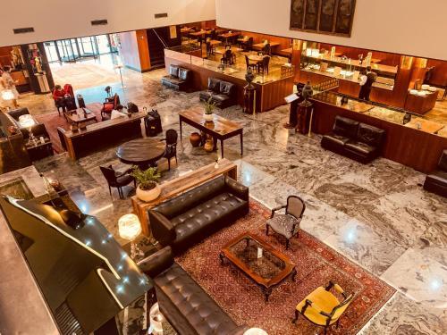Um restaurante ou outro lugar para comer em Ouro Minas Palace Hotel