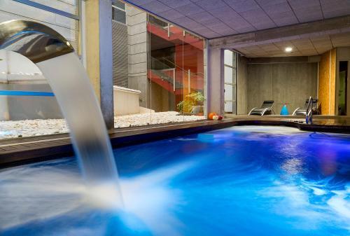The swimming pool at or near Hotel Spa La Casa del Rector