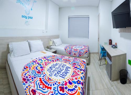 Кровать или кровати в номере Sixtina Plaza Hotel