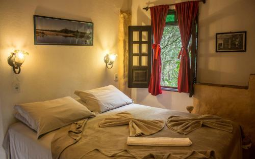 Cama ou camas em um quarto em Pousada Flor de Açucena