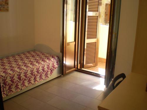 Un ou plusieurs lits dans un hébergement de l'établissement Trasteverooms La Bernardon
