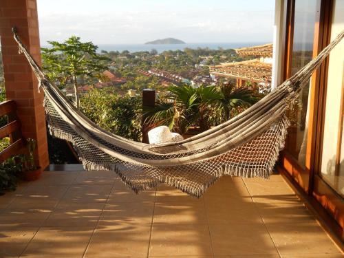 A balcony or terrace at Casa Sol e Mar com 2 Internet