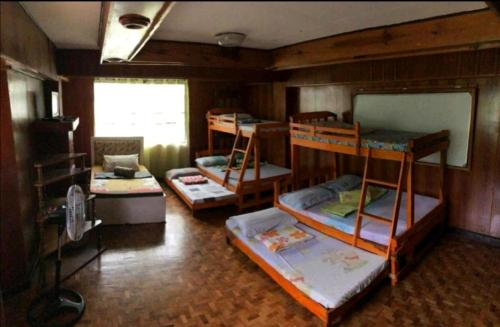A bunk bed or bunk beds in a room at Amara Transient