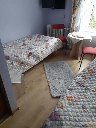 Łóżko lub łóżka w pokoju w obiekcie Pokoje Gościnne Pod Wiatrakiem