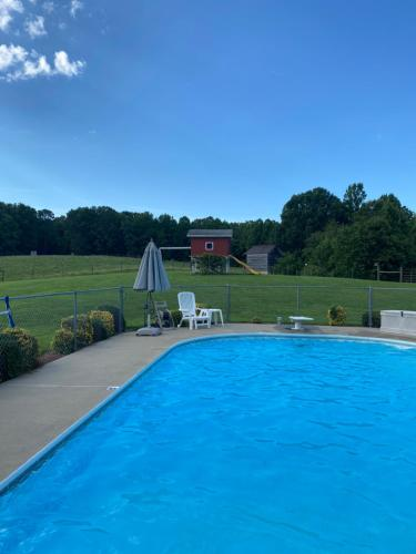 The swimming pool at or near Wolf Creek Farm B&B and Motorcycle Manor at Wolf Creek Farm