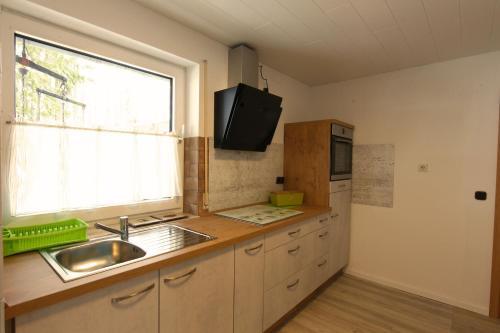 Küche/Küchenzeile in der Unterkunft Schröder's Hotelpension
