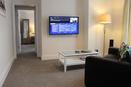 A television and/or entertainment center at Andover House Hotel