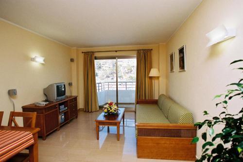 Een zitgedeelte bij Apartamentos Balansat
