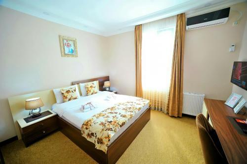 Кровать или кровати в номере Hotel Park
