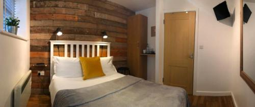 A bed or beds in a room at The Dukes