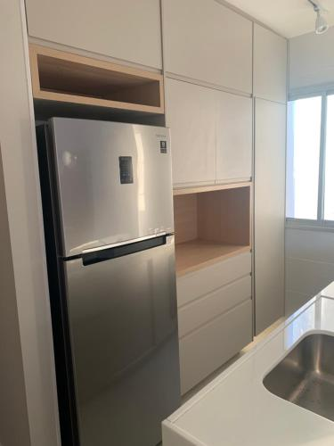 A kitchen or kitchenette at Apartamento Novo no Centro de BH, Ar Cond, WiFi, Garagem