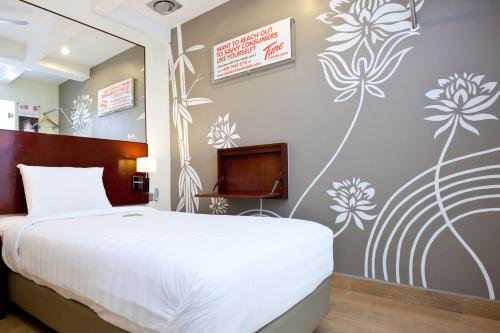 A bed or beds in a room at Tune Hotel Georgetown Penang