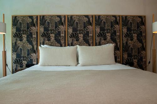 Säng eller sängar i ett rum på Port Royal Villas and Spa - Adults Only
