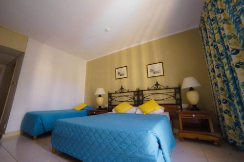A bed or beds in a room at Topaz Hotel